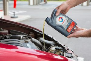 Pouring oil into your engine